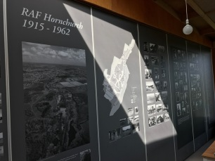 The other side of the same panels, facing the cafe, showcases the rich military history of the site and community